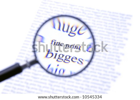 A magnifying glass, zooming in on the text Fine Print on a sheet of paper, surrounded by bigger letters. The chromatic aberration of the cheap magnifying glass with its plastic lense is intentional.