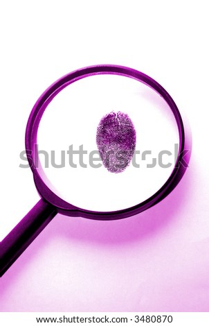 a magnifying lens over a fingerprint in purple colors - stock photo