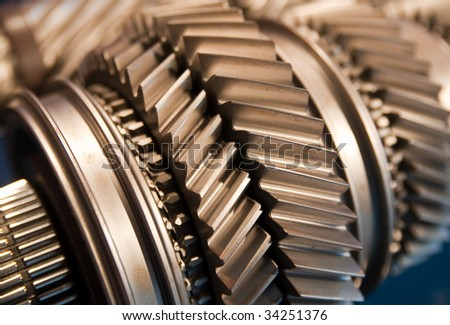 A Mainshaft and Countershaft of a transmission with gears meshing. Focus on the gears. - stock photo