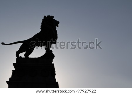 A majestic pose of a bronze lion outside Vienna on a bridge - stock photo