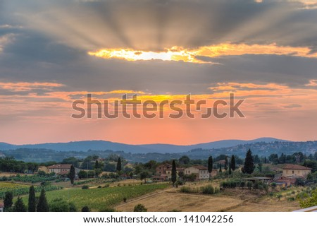 a majestic sunset in a rural zone of tuscany with vibrant colors - stock photo