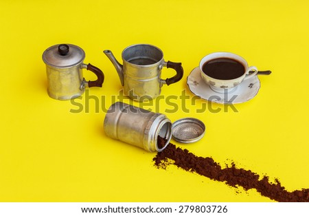 a maker of aluminium removed after filling the cup of coffee with the strip of coffee-powder that comes out from the filter - stock photo