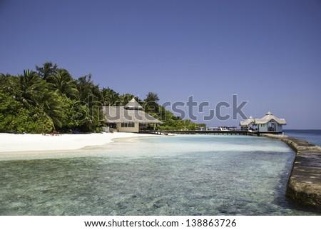 A maldivian scuba diving center in a beautiful lagoon. - stock photo