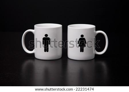 A male and female mug side by side. - stock photo