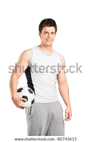A male athlete holding a football isolated on white background - stock photo
