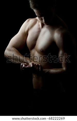a male bodybuilder flexing his muscles - stock photo