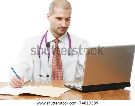 A male doctor at his workplace - stock photo