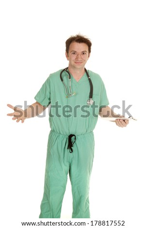 A male doctor in green scrubs and a stethoscope around his neck. - stock photo