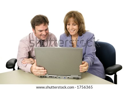 A male-female business team with a laptop, happy over their success.  Isolated.