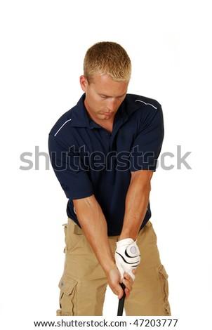 A male golfer swinging a golf club - stock photo