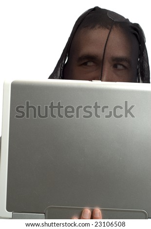 A male hacker wearing a pair of stockings, is working on a laptop computer, isolated against a white background