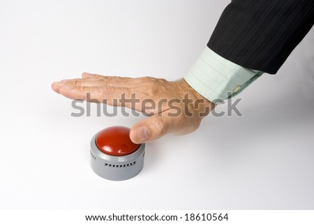 A male hand actuating a panic button.