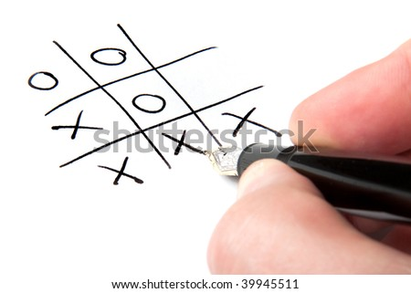A male hand winning at tic-tac-toe.