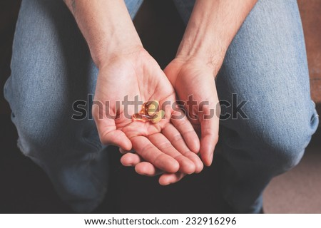 A male hand with pills