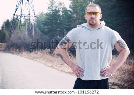 A male runner envisions his pace before the run - stock photo