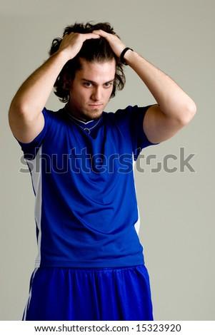 A male soccer player. Studio shot. - stock photo