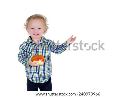 A male toddler holds an apple and gestures with his hand, as if saying something. Isolated on white. - stock photo