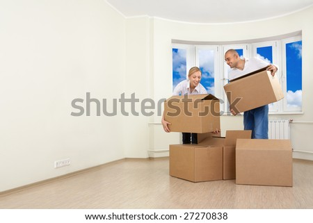 A man and a woman are unpacking - stock photo