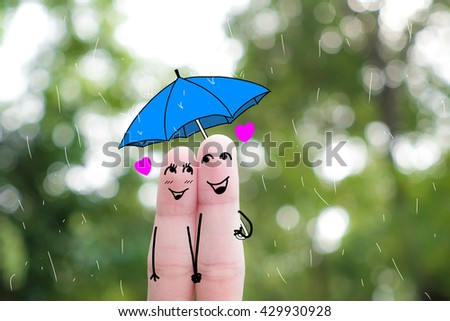 A man and a woman hug with pink hearts in the eyes. The concept of love at first sight.rainy season