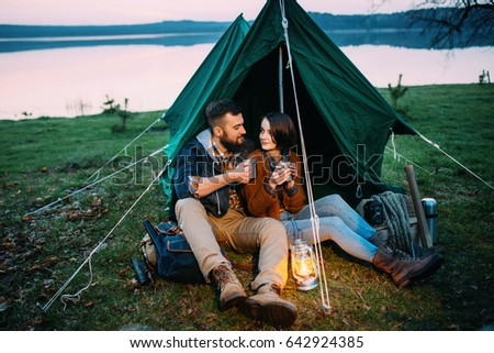 A man and a woman in a tent hold a flashlight at dawn near the lake  sc 1 st  Shutterstock & Man Woman Tent Hold Flashlight Dawn Stock Photo 642924385 ...