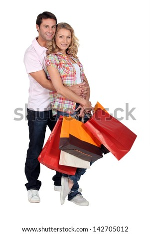 A man and a woman with  bags - stock photo