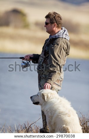 A man and his dog enjoying a day together - stock photo