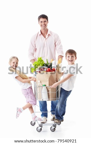 A man and two children with a cart with food on a white background - stock photo