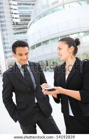 A man and woman business team at their company office building