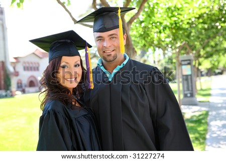 A man and woman couple at college graduation - stock photo