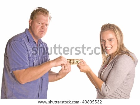 A man and woman fighting over money. - stock photo
