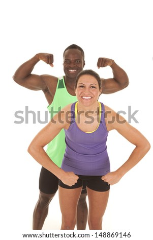 A man and woman flexing their muscles with smiles on their faces - stock photo