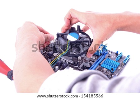 a man build computer put cpu to mainboard - stock photo
