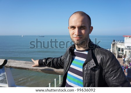 A man by the beach in Scheveningen on a sunny day - stock photo