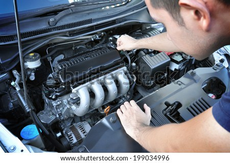 A man checking car engine - stock photo