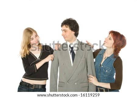A man choosing between two beautiful women - stock photo