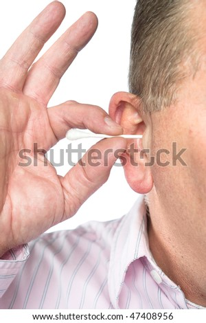 A man cleans his ear with a cotton swab for good hygiene. - stock photo