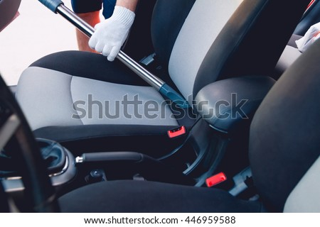 man cleans interior car vacuum cleaning stock photo 446959588 shutterstock. Black Bedroom Furniture Sets. Home Design Ideas