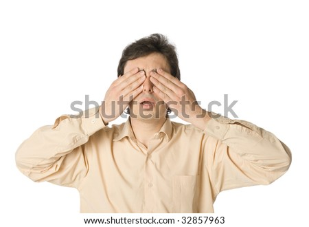 A man covering his eyes with his hands