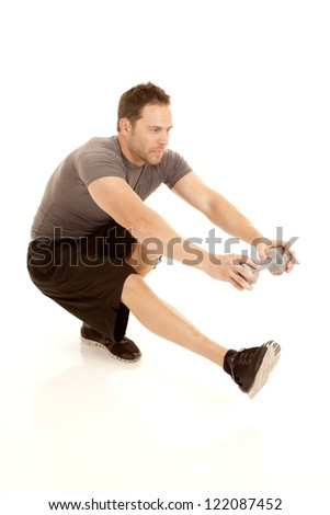 a man doing a one leg squat and holding on to a weight. - stock photo