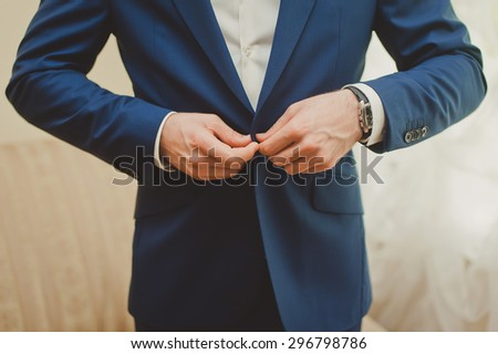 a man dressed in suit, stylish groom is going to a wedding - stock photo