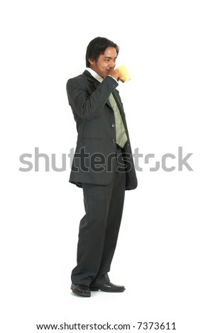 a man drinking coffee from a cup - stock photo