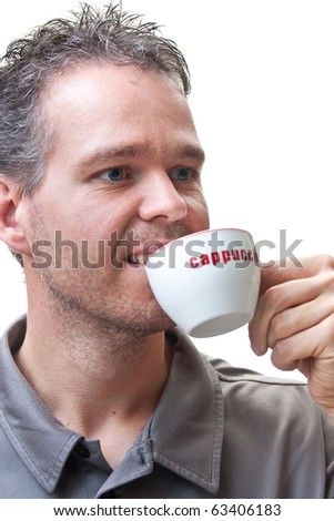 A man, drinking from a cappuccino cup, isolated on white.