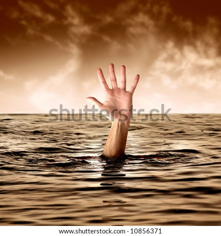 A man drowning in the sea - stock photo
