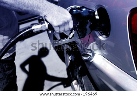 A man filling gas on his car