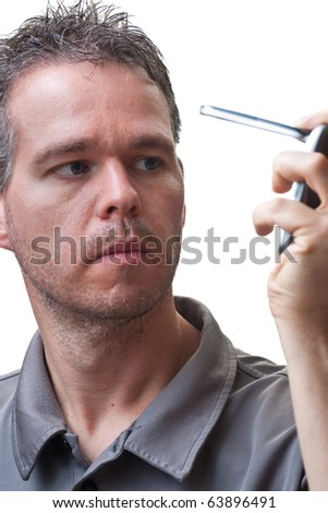A man folding closed a flip phone, isolated on white.