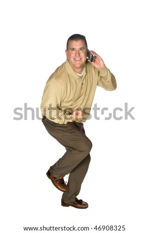 "A man gets excited after receiving positive news over his cell phone and makes a bodily expression as if saying, ""oh yea!"" - stock photo"