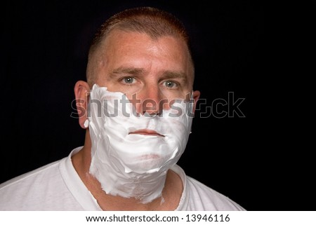 A man getting ready to shave. - stock photo