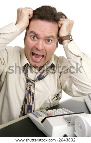 A man going crazy trying to do his own taxes.  Isolated on white. - stock photo