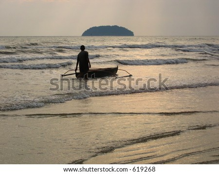 A man going out to sea with his boat - stock photo
