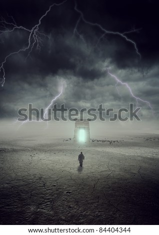 a man going to a gate in thunder storm - stock photo